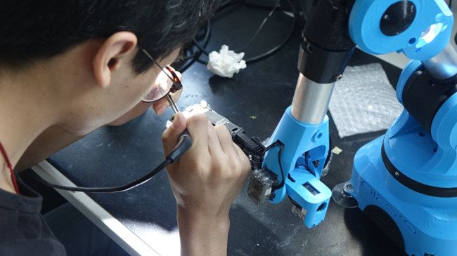 a personal robot helping you soldering
